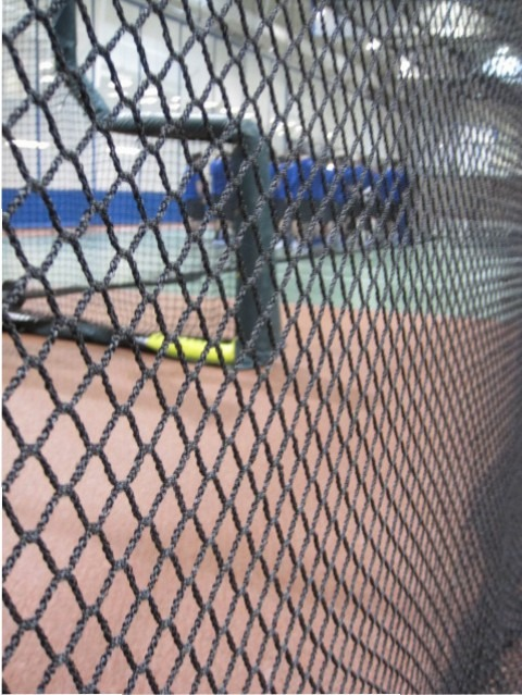 Baseball barrier net in a gymnasium