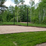 Sand volleyball with a large ball net covering it
