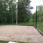 Large ball net around a sand volleyball pit